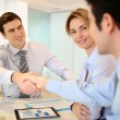 Businessmshaking hand to business partner — Stock Photo #27924865