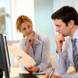 Business team working in front of desktop — Stock Photo