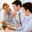 Business team working in front of desktop — Stock Photo #27924891