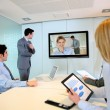 Business people attending videoconference meeting — Stok fotoğraf