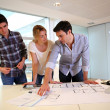 Team of architects working on construction plans — Stock Photo