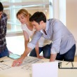 Team of architects working on construction plans — Stock Photo #27925123
