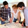 Startup business team working on blueprint — Stock Photo