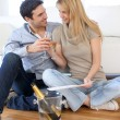 Couple celebrating for the purchase of new home — Stock Photo