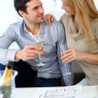 New property owners celebrating with champagne — Stock Photo #27926155