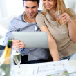 Couple celebrating construction of new home — Stock Photo