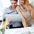 Couple celebrating construction of new home — Stock Photo #27926183