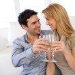 Stock Photo: Romantic couple drinking wine at home