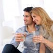Romantic couple drinking wine at home — Stock Photo