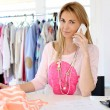 Woman designer in workshop talking on the phone — Stock Photo