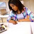 Foto Stock: Portrait of student girl writing on notebook