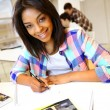 Portrait of student girl writing on notebook — Stock Photo