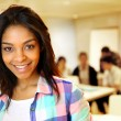 Portrait of smiling student girl — Stock Photo #27927023