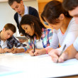 Group of teenagers in class writing an exam — Stock Photo #27927205