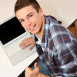 Student with laptop showing thumb up — Stock Photo