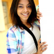 Student girl standing in college building — Stock Photo