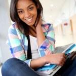 Cheerful student girl sitting on school bench — Stock Photo