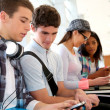 Stock Photo: Youth and technology at school