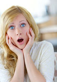 Blond woman with surprised look on her face — Stock Photo