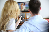 Back view of couple choosing tv program — Stock Photo