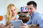Young couple choosing tv program on internet — Stock Photo