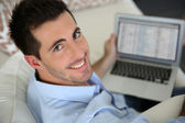 Upper view of young man using laptop computer at home — Foto Stock