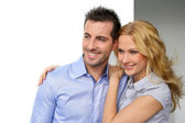 Portrait of cheerful couple looking away — Stockfoto