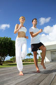 Woman with coach exercising outside — Stock Photo