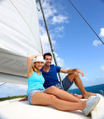 Cheerful couple cruising on a catamaran in Caribbean sea — Stock Photo