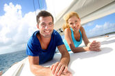 Cheerful couple cruising on a sail boat — Stock Photo