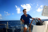 Smiling young sailor navigating in Caribbean sea — Stock Photo