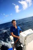 Smiling young sailor navigating in Caribbean sea — Stock Photo