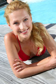 Portrait of beautiful blond girl in red bikini — Stock Photo