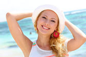 Beautiful girl wearing hat at the beach — Stock Photo
