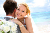 Bride embracing her groom — Stock Photo