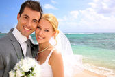 Portrait of beautiful bride and groom at the beach — Stock Photo