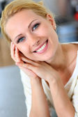 Portrait of beautiful blond woman with hand on chin — Stock Photo