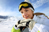 Portrait of cheerful blond woman at ski resort — Stock Photo