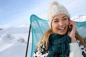 Woman in ski resort using smartphone — Stock Photo
