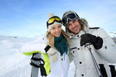 Cheerful couple enjoying winter vacation — ストック写真