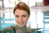 Blond woman relaxing in spa pool — Stock Photo