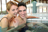 Couple enjoying bathtime in spa resort — Stock Photo