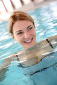 Woman in spa center swimming-pool — Stock Photo