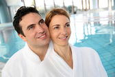 Portrait of couple in bathrobe standing in spa center — Stock Photo