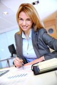 Businesswoman working on sales project — Stock Photo
