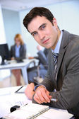 Portrait of businessman in office — Stock Photo