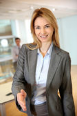 Businesswoman ready to give handshake — Stock Photo
