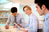 Smiling businesswoman attending meeting — Stock Photo