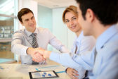 Businessman shaking hand to business partner — Stock Photo