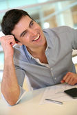 Man at work in office joking with colleague — Stock Photo